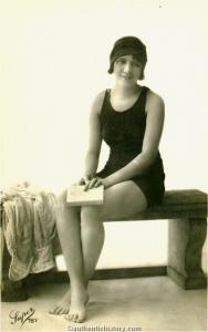 Photograph_Girl_In_Bathing_Suit_on_Stone_Bench.jpg